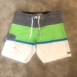 White, black, green board shorts